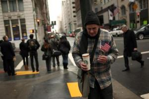 Homeless man begs for money in the Financial District in San Francisco